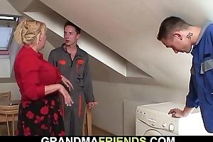 Two workers screw busty pretty good grandma