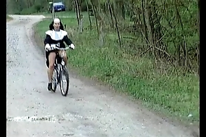 Nun atop bike