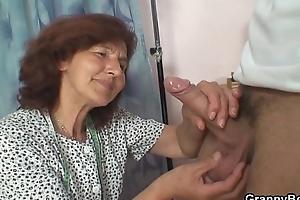 Sewing granny enjoys riding juvenile pecker