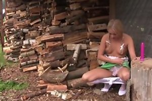 Inviting tow-headed unsubtle in cute dress plays with her coochie outdoors